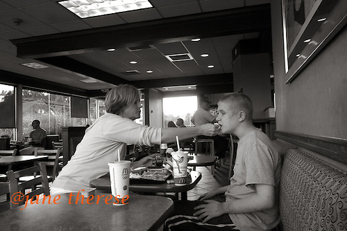 Jill and Danny go to McDonald's in Haddonfield, NJ on Wednesday September 20, 2006, as a special treat for Danny. Jill wipes Danny's mouth during their meal. Danny was placed in Bancroft, a place for neurologically disabled individuals in July of 2006, because he was hurting himself. Danny is the oldest son of Jill and Stacy McDowell and the first to be born with autism. Danny has a younger brother Drew 10 who is also autistic. Drew still lives at home. Photo by Jane Therese