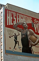 "Detroit:  ""He's Fighting for You""--sign celebrating Grant Hill of Detroit Pistons.  (A block away, another of Bernie Sanders of the Lions.)  Photo '97."