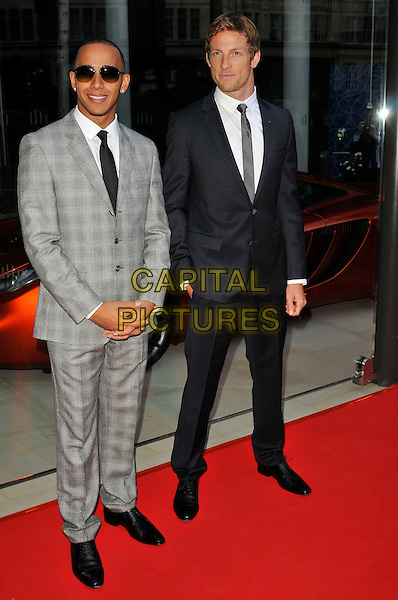Lewis Hamilton & Jenson Button.Attending the opening of McLaren London's first car showroom at One Hyde Park, London, England, UK,.21st June 2011..full length grey gray checked check plaid suit sunglasses black tie white shirt formula F1 one 1 racing drivers .CAP/CAS.©Bob Cass/Capital Pictures.