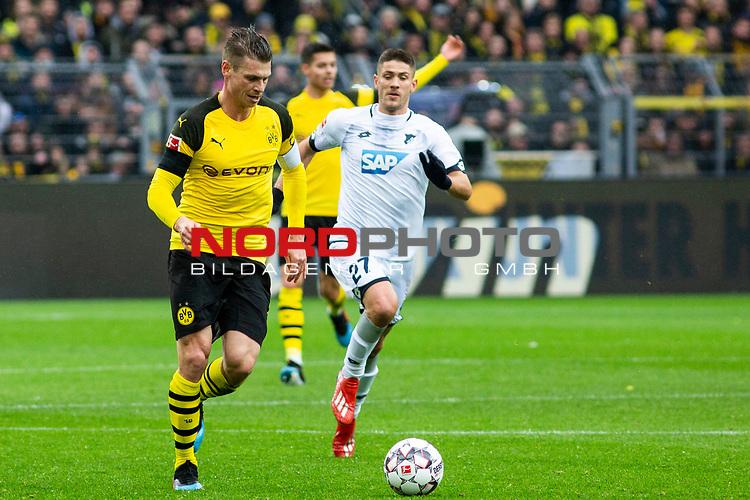 09.02.2019, Signal Iduna Park, Dortmund, GER, 1.FBL, Borussia Dortmund vs TSG 1899 Hoffenheim, DFL REGULATIONS PROHIBIT ANY USE OF PHOTOGRAPHS AS IMAGE SEQUENCES AND/OR QUASI-VIDEO<br /> <br /> im Bild | picture shows:<br /> Lukasz Piszczek (Borussia Dortmund #26) setzt sich gegen Andrej Kramaric (Hoffenheim #27)  durch, <br /> <br /> Foto &copy; nordphoto / Rauch