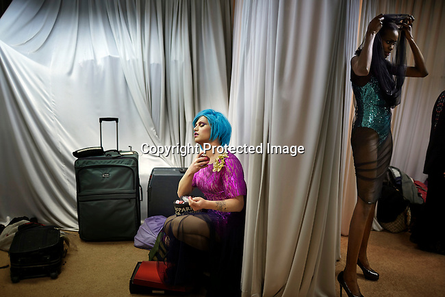 CAPE TOWN, SOUTH AFRICA - JULY 26: A model being dressed before an installation show at the new Klûk CGDT flagship store during Mercedes-Benz Fashion Week on July 26, 2014, in Cape Town, South Africa. Klûk CGDT, created by the designers Malcolm KLûK and Christiaan Gabriel Du Toit. The elite of Cape Town came out for the launch of the store and the late night party. (Photo by Per-Anders Pettersson)
