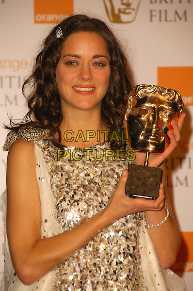 MARION COTILLARD.Pressroom at The Orange British Academy Film & Television Awards 2008 at the Royal Opera House, Covent Garden, London, England. .February 10th, 2008 .BAFTA Arts half length white silver sequins sequined white  award trophy.CAP/CAS.©Bob Cass/Capital Pictures.