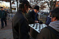 (171128RREI2292) La Esquina where Latinos have gathered for decades at the corner of Mt. Pleasant St. and Kenyon St. NW. to play checkers (damas). Washington DC.  Nov. 28 ,2017 . ©  Rick Reinhard  2017     email   rick@rickreinhard.com