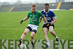 Eoin Murphy (St Kierans) in action with Martin Collins (Shannon Rangers)  in the Acorn Life under 21 County Football Championship Semi Final at Austin Stack Park, Tralee on Wednesday evening.