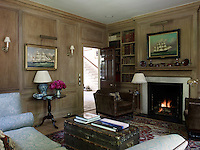The library is panelled in oak and is comfortably furnished