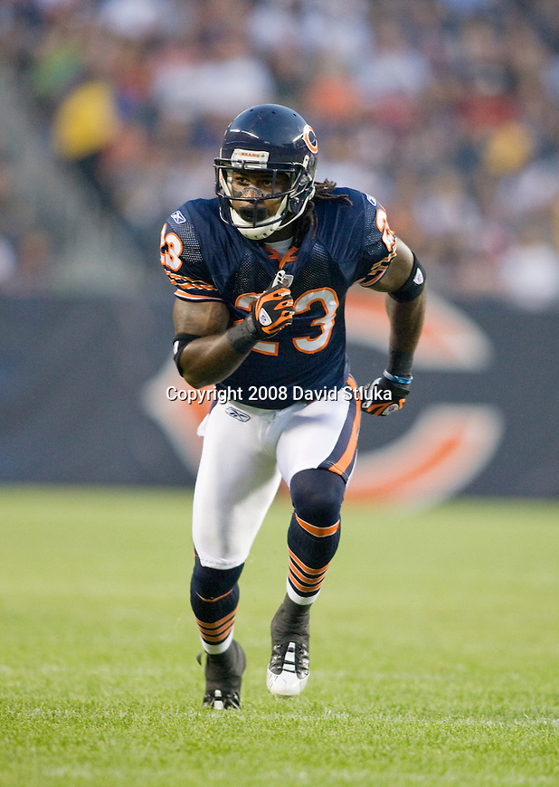 Kick returner/wide receiver Devin Hester #23 of the Chicago Bears returns a kick against the San Francisco 49ers at Soldier Field on August 21, 2008 in Chicago, Illinois. The 49ers defeated the Bears 37-30. (AP Photo/David Stluka)