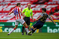 4th July 2020; Bet365 Stadium, Stoke, Staffordshire, England; English Championship Football, Stoke City versus Barnsley; Nick Powell of Stoke City is tackled by Alex Mowatt of Barnsley
