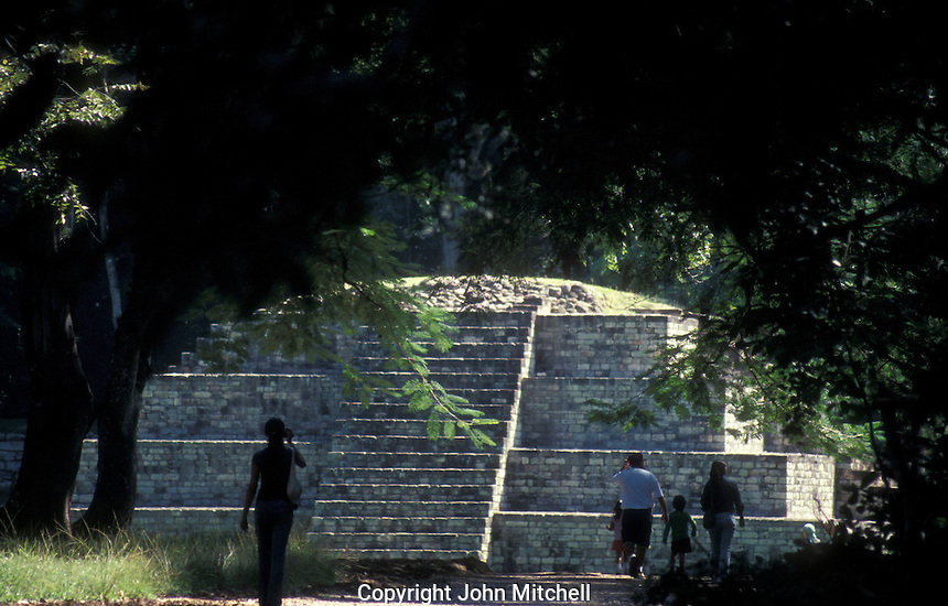 Tourists walking down a path leading to the Mayan ruins of Copan, Honduras