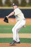 Wake Forest Demon Deacons relief pitcher Will Craig (22) in action against the Marshall Thundering Herd at Wake Forest Baseball Park on February 17, 2014 in Winston-Salem, North Carolina.  The Demon Deacons defeated the Thundering Herd 4-3.  (Brian Westerholt/Four Seam Images)