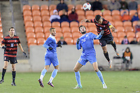 Houston, TX -  Friday, December 9, 2016: Brian Nana-Sinkam (8) of the Stanford Cardinal heads the ball over Tucker Hume (36) of the North Carolina Tar Heels in the first half of the  NCAA Men's Soccer Semifinals at BBVA Compass Stadium.