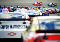 Sept. 20, 2008; Dover, DE, USA; Nascar Sprint Cup Series drivers wait in line to head onto the track during practice for the Camping World RV 400 at Dover International Speedway. Mandatory Credit: Mark J. Rebilas-