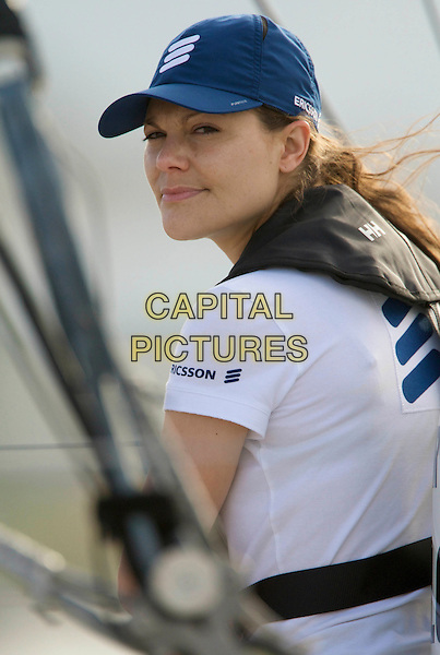 CROWN PRINCESS VICTORIA OF SWEDEN.On board the sail boat Ericsson 4 during the Volvo Ocean Race 2008 - 2009, Marina Gloria, Rio de Janeiro, Brazil, April 3rd 2009..swedish royal family half length blue cap hat white t-shirt.CAP/PPG/JH.©Jens Hartmann/People Picture/Capital Pictures