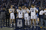 Nevada guard Nisré Zouzoua (5) with his teammates on Senior night after a basketball game against San Diego State played at Lawlor Events Center in Reno, Nev., Saturday, Feb. 29, 2020. (AP Photo/Tom R. Smedes)