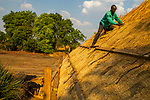 Roof being thatched, Kafue National Park, Zambia