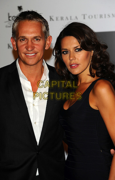 GARY LINEKER & DANIELLE LINEKER Attending Your Moment Is Waiting - launch party at Saatchi Gallery, London, England. September 21st 2010 .half length black dress jacket white shirt married couple husband wife sleeveless bux .CAP/CJ.©Chris Joseph/Capital Pictures.