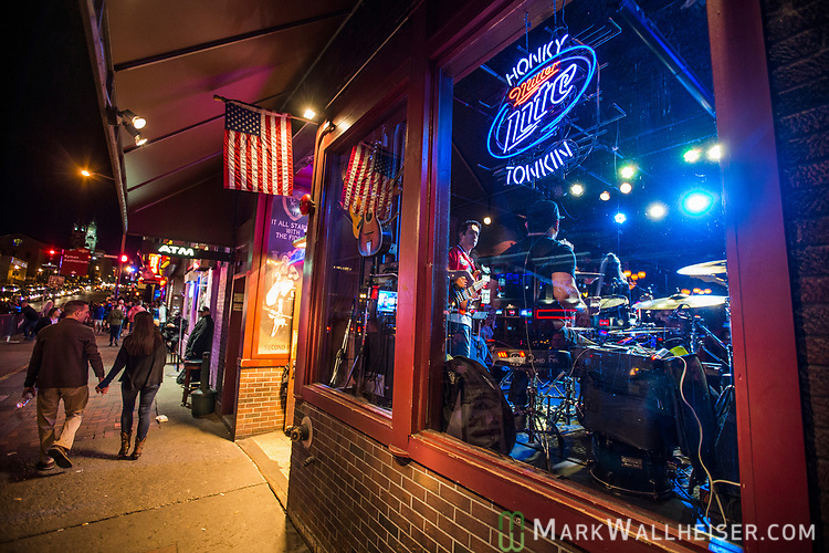 Musicians play play in the windows of the bars on lower Broadway in Nashville, Tennessee