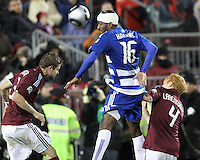 Atiba Harris#16 of FC Dallas heads between Drew Moor#3 and Jeff Larentowicz#4 of the Colorado Rapids during MLS Cup 2010 at BMO Stadium in Toronto, Ontario on November 21 2010. Colorado won 2-1 in overtime.