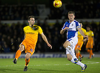 Matt Bloomfield of Wycombe Wanderers knocks the ball past Lee Mansell of Bristol Rovers during the Sky Bet League 2 rearranged match between Bristol Rovers and Wycombe Wanderers at the Memorial Stadium, Bristol, England on 1 December 2015. Photo by Andy Rowland.