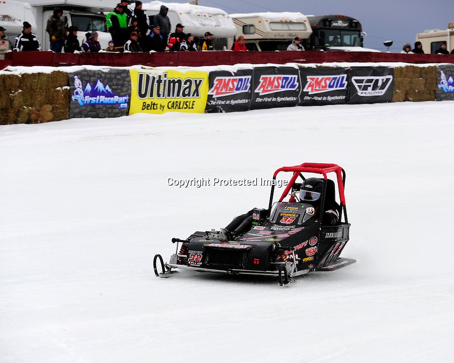 Tim Hibbard of Lempster, NH races in the Outlaw 600 class at the AMSOIL World Championship Snowmobile Derby, Eagle River, WI, Jan. 19, 2014.