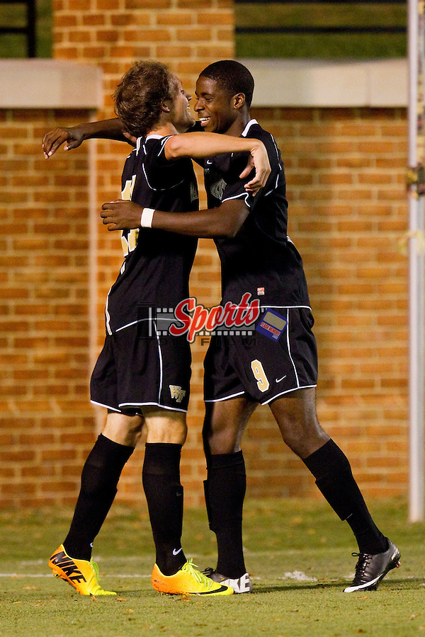 Sean Okoli (right) of the Wake Forest Demon Deacons hugs teammate Luca Gimenez (left) after scoring a goal against the Virginia Cavaliers at Spry Soccer Stadium on September 13, 2013 in Winston-Salem, North Carolina.  The Demon Deacons defeated the Cavaliers 3-2.  (Brian Westerholt/Sports On Film)