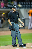 Home plate umpire Tyler Olson between innings of the Carolina League game between the Frederick Keys and the Winston-Salem Dash at BB&T Ballpark on May 24, 2016 in Winston-Salem, North Carolina.  The Keys defeated the Dash 7-1.  (Brian Westerholt/Four Seam Images)
