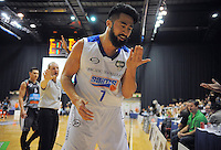 Damien Ekenasio reacts after a collision during the national basketball league final between Wellington Saints and Bay Hawks at TSB Bank Arena, Wellington, New Zealand on Saturday, 5 July 2014. Photo: Dave Lintott / lintottphoto.co.nz