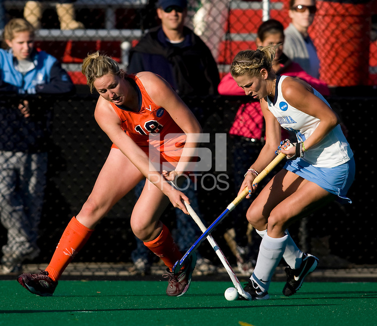 Katie Ardrey (11) of UNC fights for the ball with Elly Buckley (21) of Virginia during the NCAA Field Hockey Championship semfinals in College Park, MD.  North Carolina defeated Virginia, 4-3, in overtime.