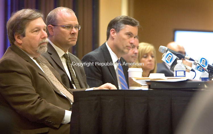 WATERBURY CT. 16 October 2014-101414SV02-From left, Henry Salton, Asst. Attorney General, Gary Hawes, Asst. Attorney General, and Perry Zinn Rowthorn, Deputy Attorney General listen to testimony during a public hearing on Tenet Healthcare's proposal to acquire Saint Mary's Hospital at the Courtyard by Marriott in Waterbury Thursday.<br /> Steven Valenti Republican-American