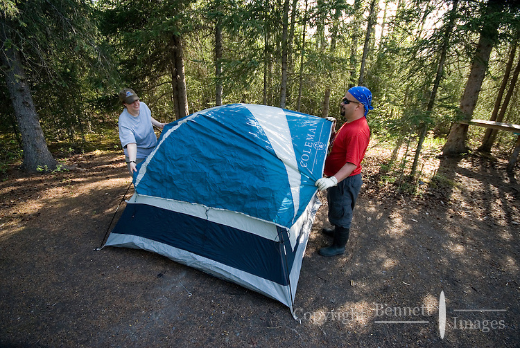 Kirsten Olsen and Nick Lynch set up their tent at a campsite along the Kenai River.