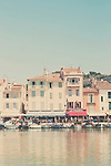 A photograph of the harbor in the town of Cassis, France.