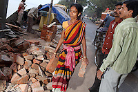 A woman carries bricks on a worksite in central Kolkata.<br /> <br /> To license this image, please contact the National Geographic Creative Collection:<br /> <br /> Image ID: 1925856 <br />  <br /> Email: natgeocreative@ngs.org<br /> <br /> Telephone: 202 857 7537 / Toll Free 800 434 2244<br /> <br /> National Geographic Creative<br /> 1145 17th St NW, Washington DC 20036
