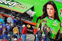 Fans crowd the souvenir trailer of driver Danica Patrick (#10).