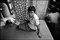 Siem Reap, Cambodia, December 2006..Lom Luan, 18, suffers from 'level 3 cerebral palsy', a very serious mental and physical condition, usually consecutive to a genetic disorder.  She is being taken care of in the Handicap International clinic.