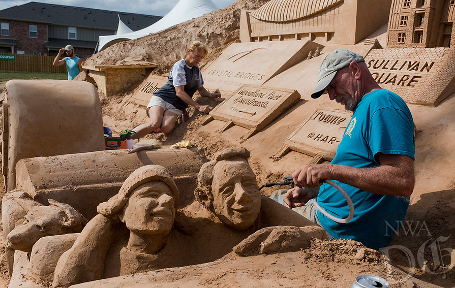 NWA Democrat-Gazette/CHARLIE KAIJO Artist Dan Doubleday builds a sand sculpture on Saturday, October 21, 2017 at Sullivan Square in Bentonville. Four artists started the sand project on Monday that will involved about 275 hours of building time and 280 tons of sand.