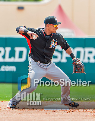 19 March 2015: Miami Marlins infielder Donovan Solano turns a double-play in the first inning during Spring Training action against the Atlanta Braves at Champion Stadium in the ESPN Wide World of Sports Complex in Kissimmee, Florida. The Braves defeated the Marlins 6-3 in Grapefruit League play. Mandatory Credit: Ed Wolfstein Photo *** RAW (NEF) Image File Available ***