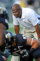 17 September 2011:  FIU Assistant Coach Cedric Calhoun puts his players through drills prior to the game.  The FIU Golden Panthers defeated the University of Central Florida Golden Knights, 17-10, at FIU Stadium in Miami, Florida.