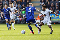 Wayne Routledge of Swansea City (R) challenges Aden Flint of Cardiff City during the Sky Bet Championship match between Swansea City and Cardiff City at the Liberty Stadium, Swansea, Wales, UK. Sunday 27 October 2019