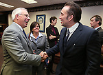 Nevada Assembly Minority Leader Pat Hickey, R-Reno, talks with actor Nicolas Cage at the Legislative Building Carson City, Nev., on Tuesday, May 7, 2013. Las Vegas City Manager Betsy Fretwell is at center. .Photo by Cathleen Allison