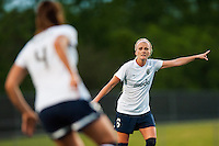 Seattle Reign FC midfielder Kaylyn Kyle (6) gives interactions to defender Kate Deines (4). Sky Blue FC defeated the Seattle Reign FC 2-0 during a National Women's Soccer League (NWSL) match at Yurcak Field in Piscataway, NJ, on May 11, 2013.