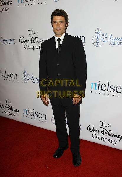CARLOS BERNARD.24th Annual Imagen Awards held The Beverly Hilton Hotel,  Beverly Hills, California, USA..August 21st, 2009.full length black suit .CAP/ADM/KB.©Kevan Brooks/AdMedia/Capital Pictures.