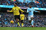 Kelechi Iheanacho of Manchester City shoots at goal past Joleon Lescott of Aston Villa - Barclay's Premier League - Manchester City vs Aston Villa - Etihad Stadium - Manchester - 05/03/2016 Pic Philip Oldham/SportImage