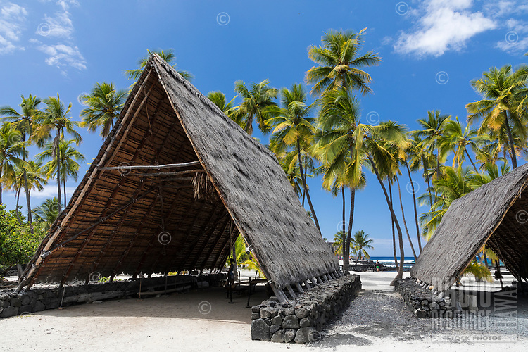 Two traditional thatched Hawaiian hale at Pu'uhonua o Honaunau, or City of Refuge, Big Island of Hawai'i.