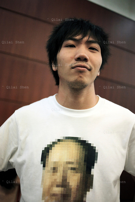 A Chinese youth wearing a Mao shirt photographed in Shanghai, China on 27 July 2009.