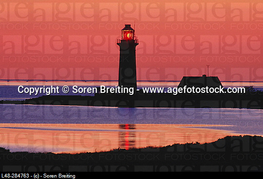 Lighthouse at sunset at Omoe Island. Denmark