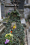 "A grave covered in ivy and flowers in Vysehrad Cemetery in Vysehrad or the ""Castle on the heights,"" an area of Prague that includes a large fortress and park, Czech Republic, Europe"