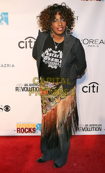 MACY GRAY.At Fashion Rocks held at Radio City Music Hall,.New Tork, 8th September 2005.full length black t-shirt grey gray jacket tassle skirt.Ref: ADM/JL.www.capitalpictures.com.sales@capitalpictures.com.© Capital Pictures.