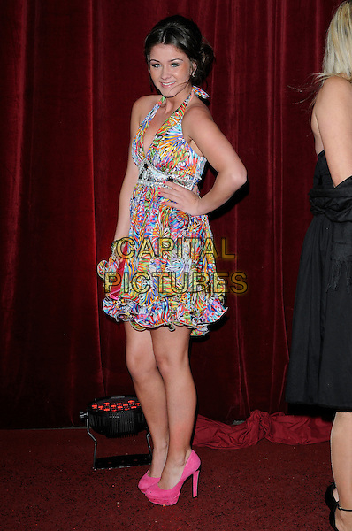 BROOKE VINCENT .wearing Lipsy dress.Attending The British Soap Awards 2010, The London Television Centre, London, England, UK, 8th May 2010 .arrivals full length pink blue multi-coloured halterneck shoes platform heels hand on hip ruffle hem tiered .CAP/CAN.©Can Nguyen/Capital Pictures.