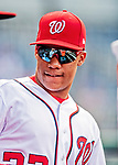 26 September 2018: Washington Nationals rookie outfielder Juan Soto awaits the start of play in the dugout prior to a game against the Miami Marlins at Nationals Park in Washington, DC. The Nationals defeated the visiting Marlins 9-3, closing out Washington's 2018 home season. Mandatory Credit: Ed Wolfstein Photo *** RAW (NEF) Image File Available ***