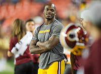 Landover, MD - August 24, 2018: Washington Redskins running back Adrian Peterson (26) relaxes on the sidelines after first half action of preseason game between the Denver Broncos and Washington Redskins at FedEx Field in Landover, MD. The Broncos defeat the Redskins 29-17. (Photo by Phillip Peters/Media Images International)