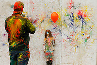 EXCHANGE PLACE, NJ - MAY 7 : A father take a picture of his daughter while people take part during Holy hai celebrations on May 7, 2016 in Exchange Place, New Jersey. Thousands of people of all ages attend Holi hai festivities also known as the festival of colors or the festival of sharing love, by Indian culture.  Photo by VIEWpress